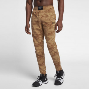 Image of Nike Dri FIT Kyrie Men's Printed Basketball Trousers Gold